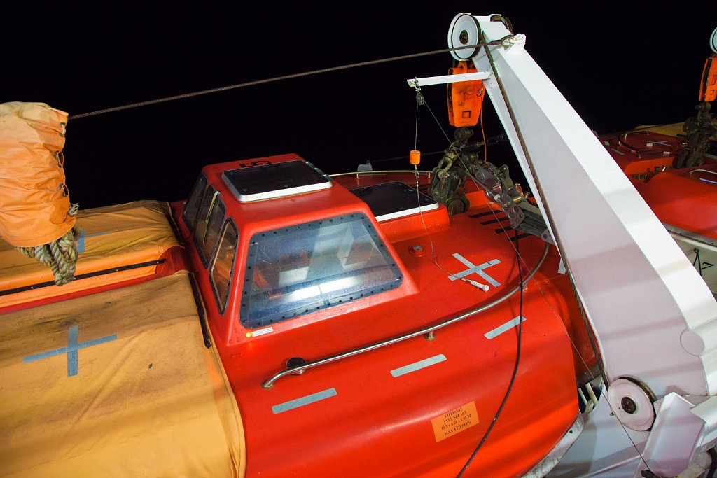 Modern lifeboat at night on a Carnival Cruise ship