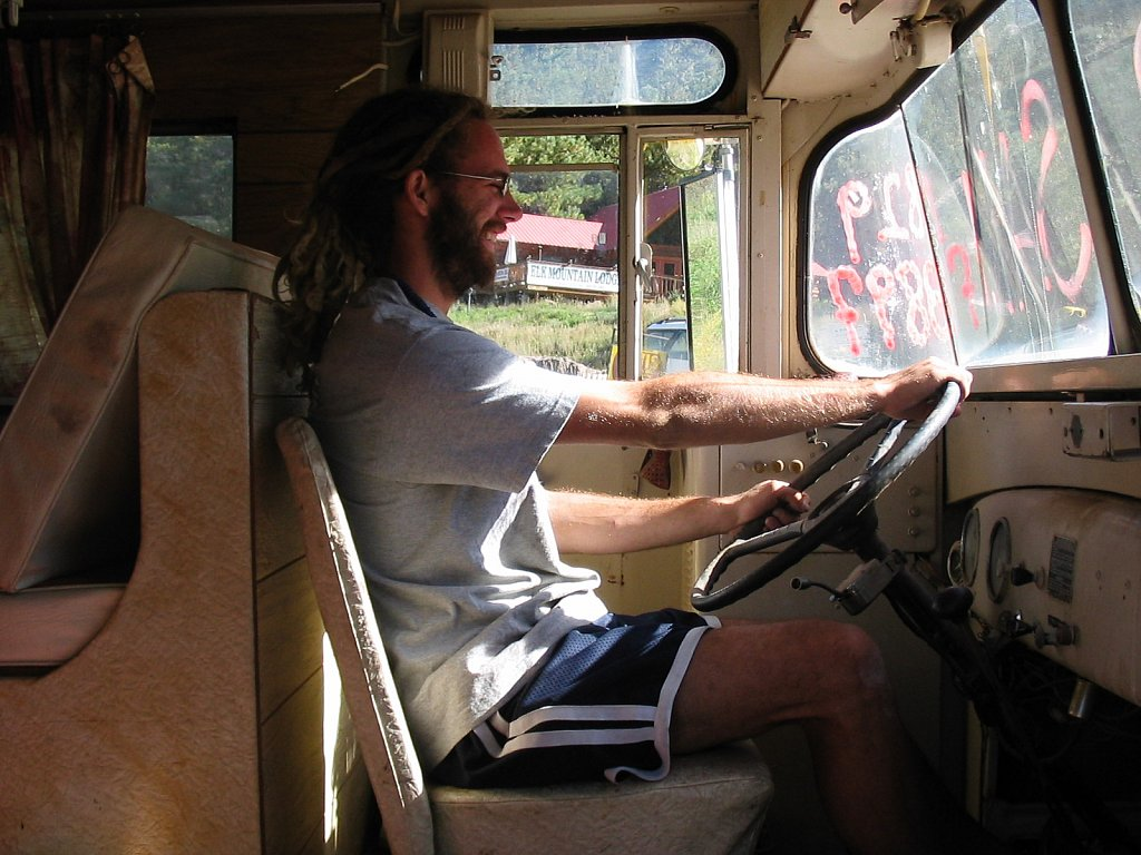 Crhis behind the wheel of the bus