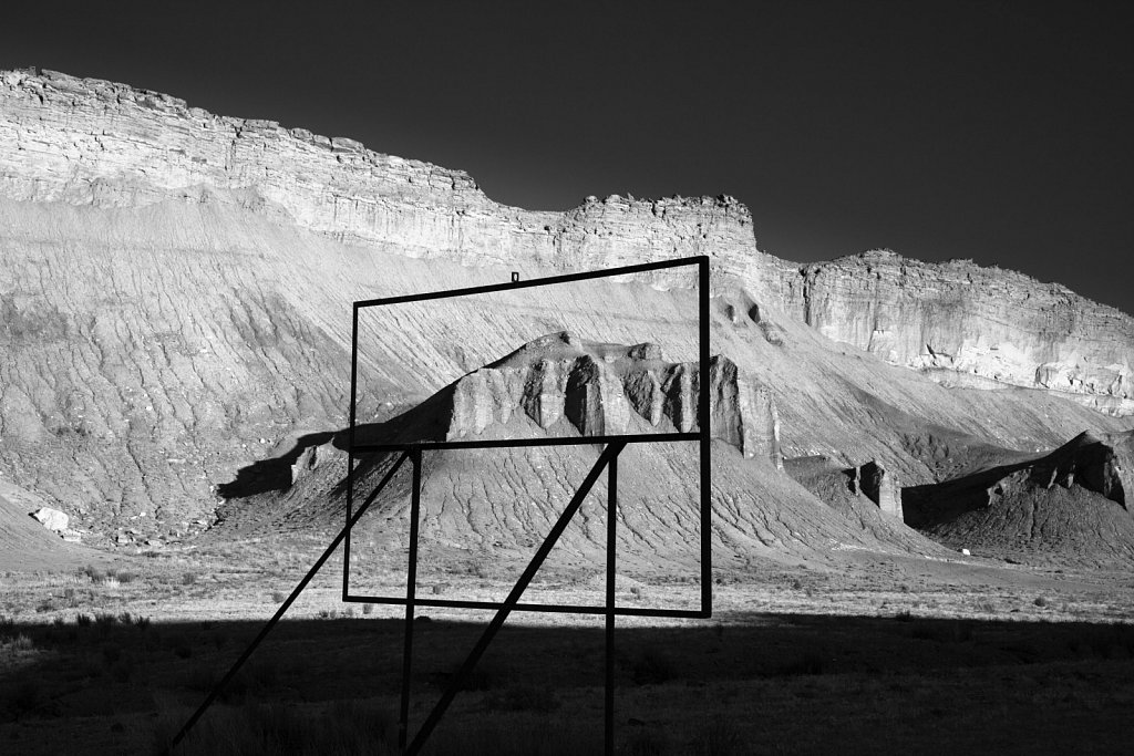 Frame of old roadside sign and sandstone cliffs in southern Utah