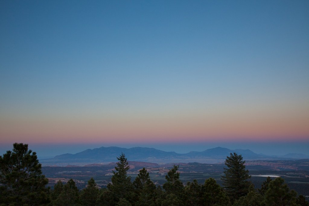 Dusk over trees and sandstone in southern utah