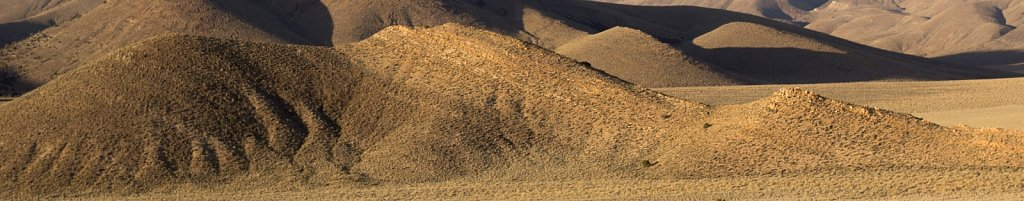 Bald beige hills near Death Valley
