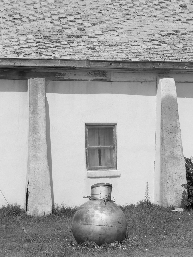 Old building and round gas tank