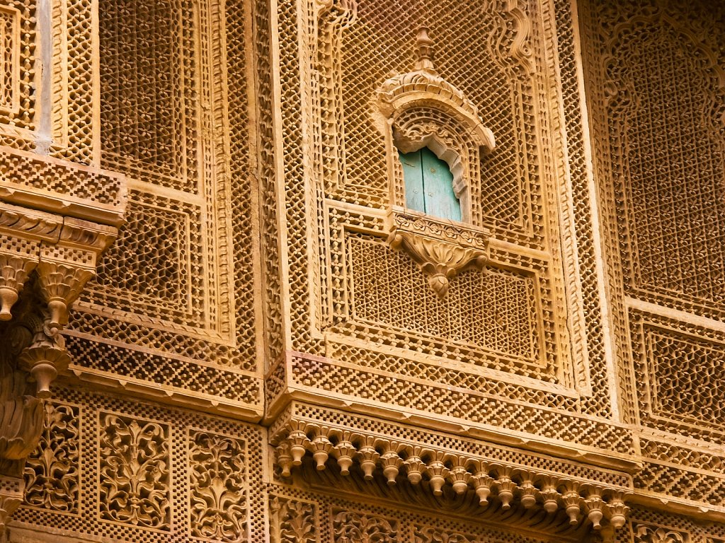 Ornate sandstone carved walls in the womens palace of Jaisalmer