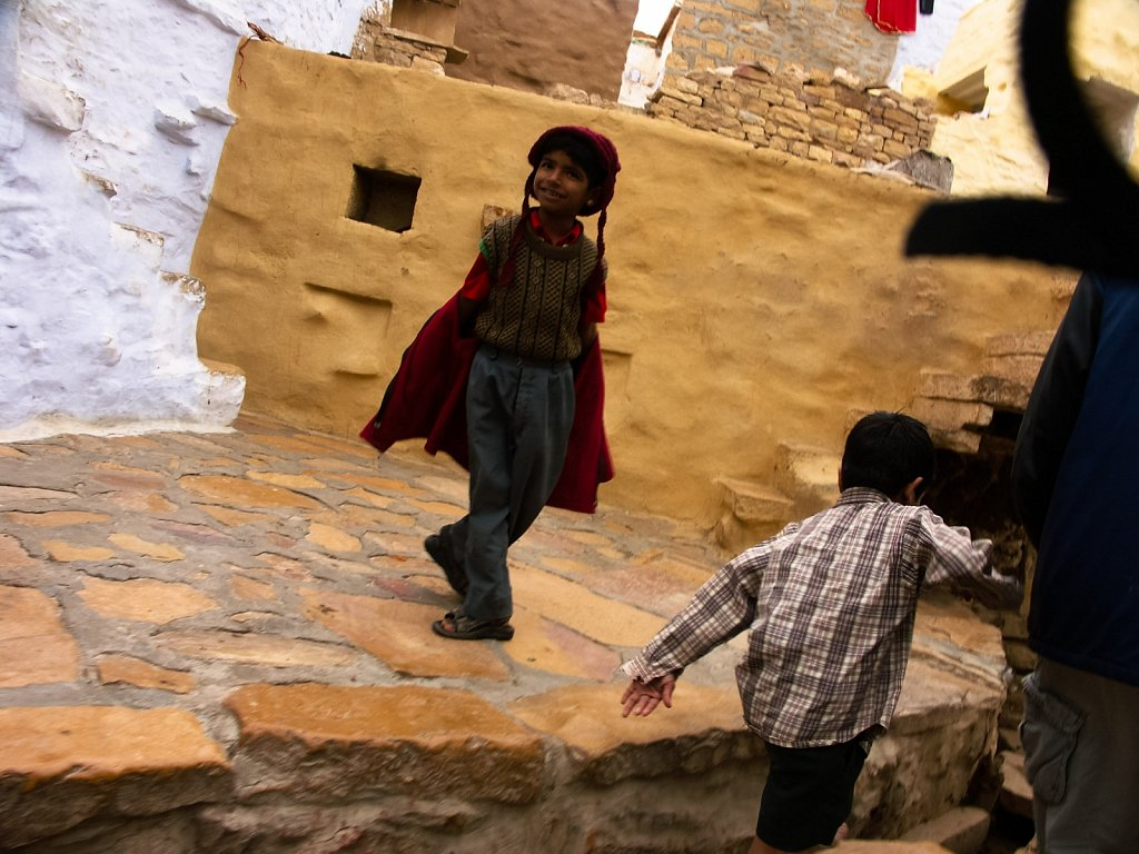 Two small boys play in the back streets of Jaisalmer Rajasthan