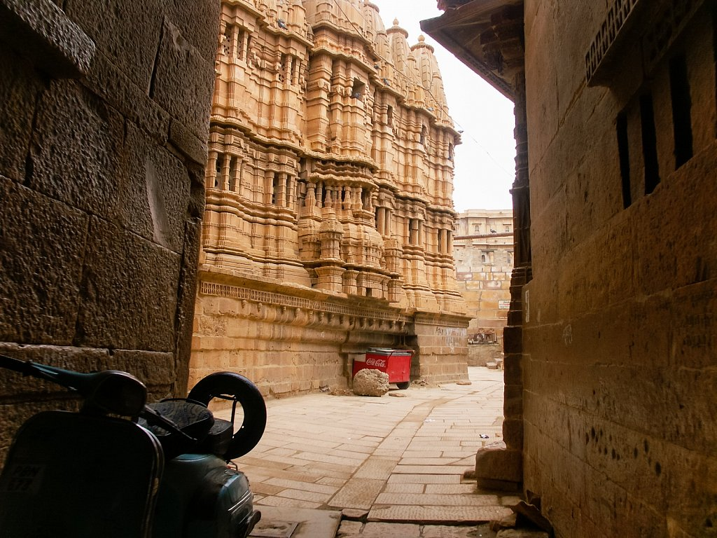 Scooter in front of ornate carved sandstone Jain temple in Jaisa