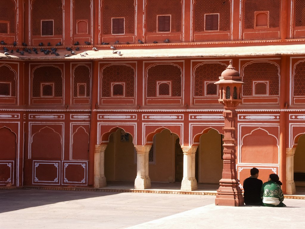 Couple relaxes in a pink castle in Jaipur India