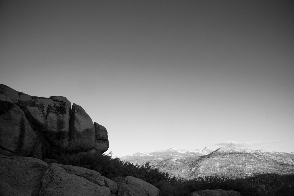 Granite rocks n the foreground and in the peaks of the Yosemite