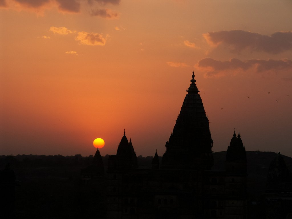 Sun sets behind temple in Orcha India