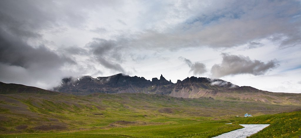 Jagged mountains and river valley in northeastern Iceland