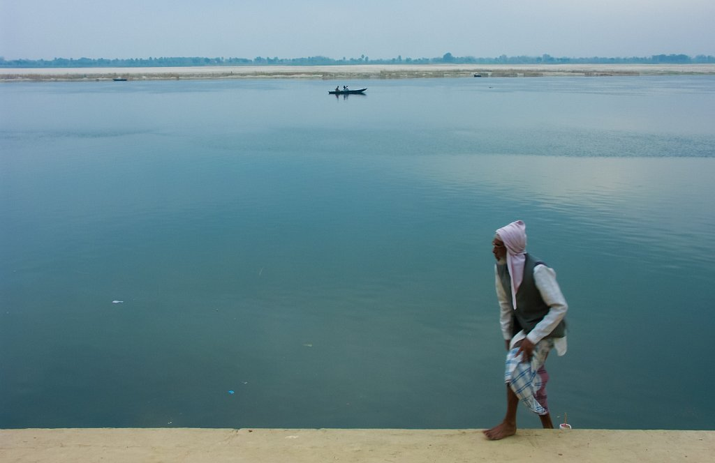 Man steps up from the Ganges in Varanasi