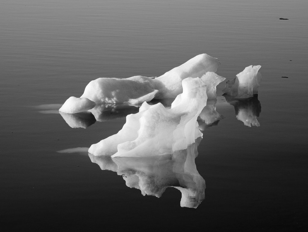 Black and white image of small iceberg in Jökulsárlón lagoon