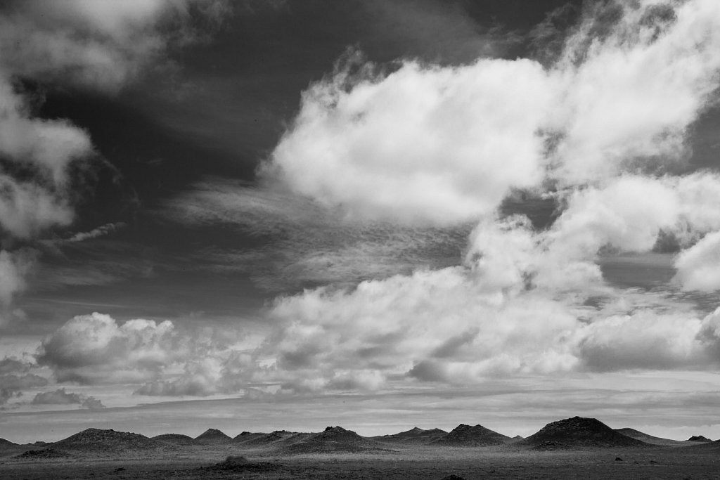 Volcanic cinder cone plain and clouds in southern Iceland