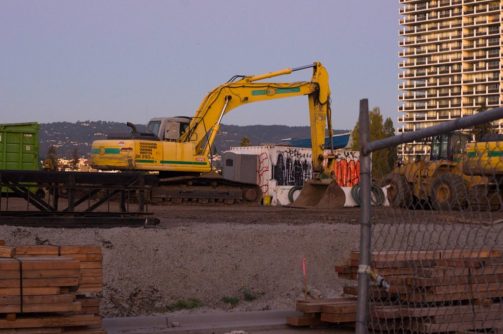Construction scene at dusk at the south end of Lake Merritt in O