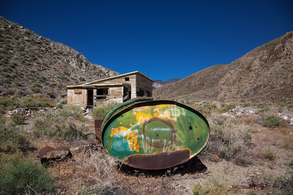 Old diesel tank and mining shack in death valley national park