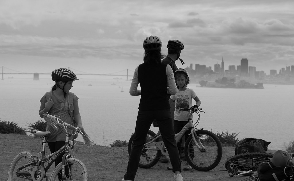 Family on bikes looks out