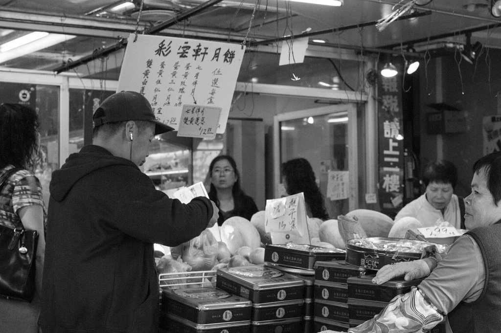 Shoppers in a Chinatown market