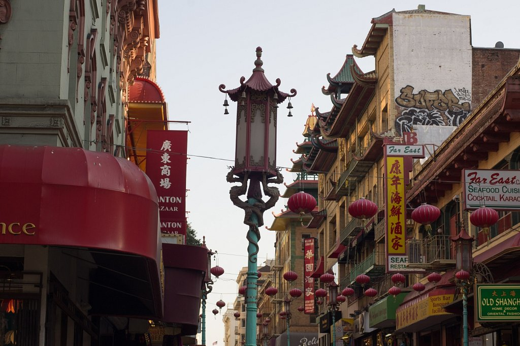 Chinatown street scene with lanterns and ornate lamps