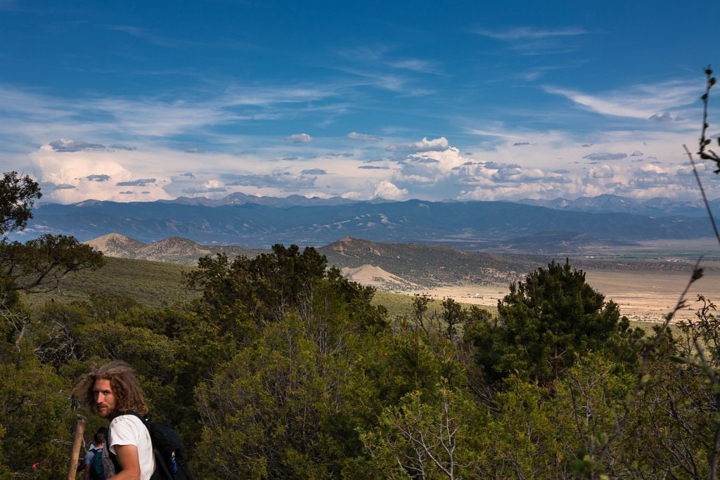 Kyle looks out from the woods above the San Luis Valley in Color