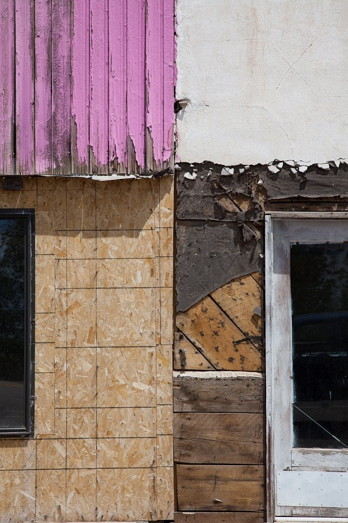 Old building detail with plywood and pink painted slats