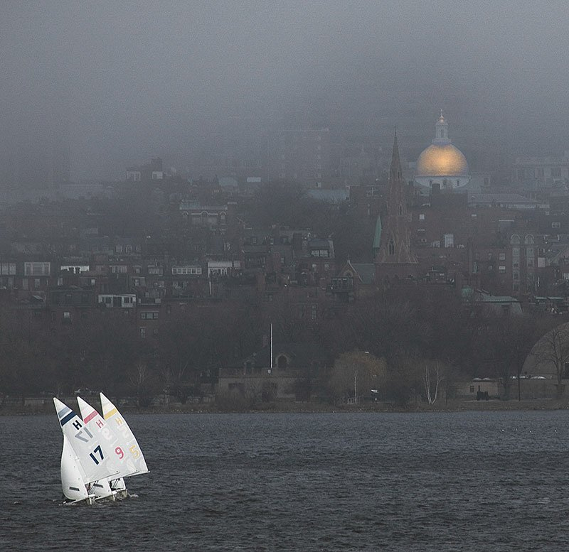 Three sailboats and the golden dome of the Massachusetts State H