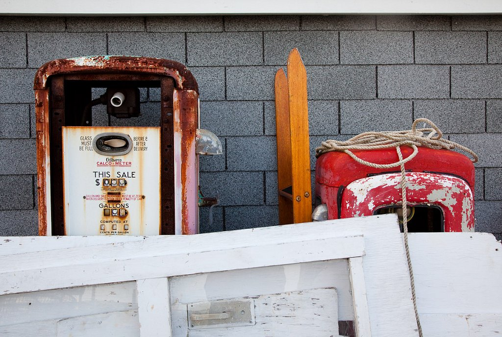 Old gas pumps, doors, and line for fishing nets, on the docks, K