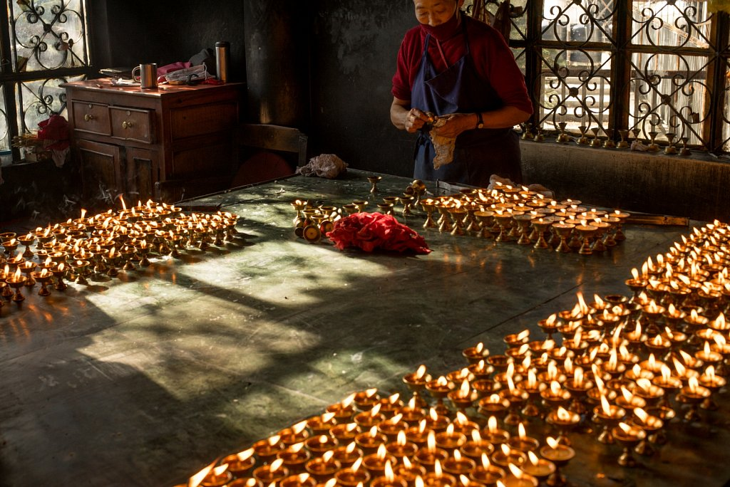 Buddhist Monk lighting candles